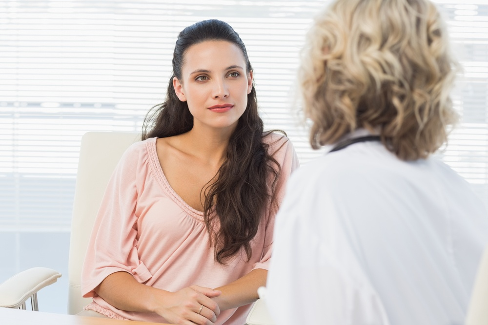 Female patient listening to doctor with concentration-1
